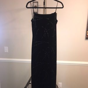 Black gown with beautiful sequins design.